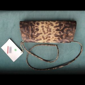 Rodo python skin clutch bag